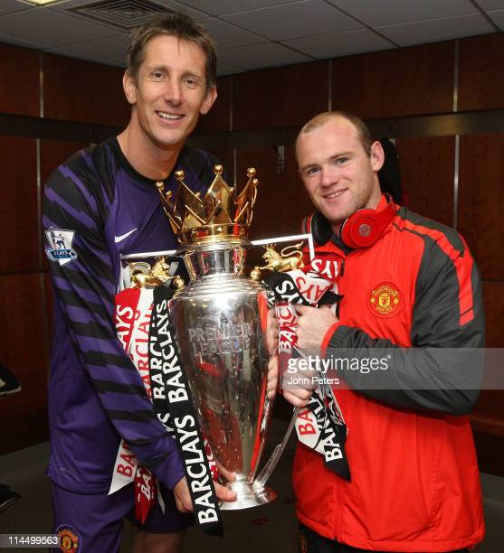 Edwin van der Sar and Wayne Rooney of Manchester United poses in the dressing room with the Barclays Premier League trophy after the Barclays Premier...