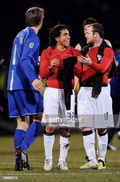 Edwin van der Sar Carlos Tevez and Wayne Rooney of Manchester United celebrate their draw following the UEFA Champions League first knockout round...
