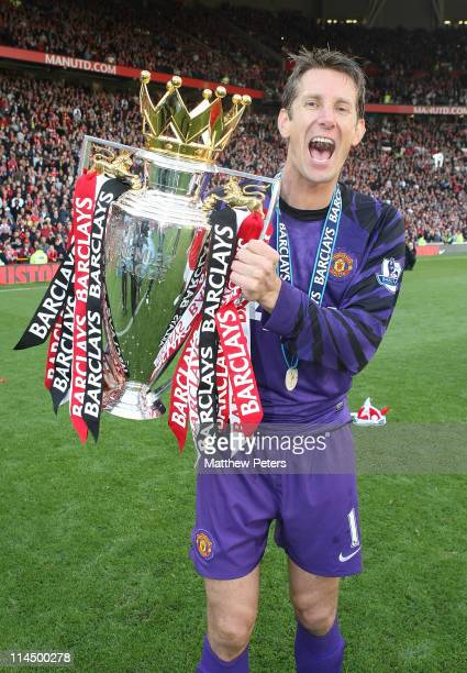 Edwin van der Sar of Manchester United celebrates with the Barclays Premier League trophy after the Barclays Premier League match between Manchester...