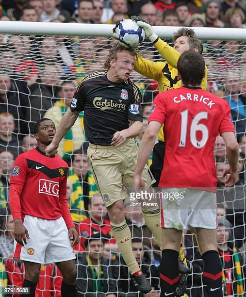 Edwin van der Sar of Manchester United clashes with Dirk Kuyt of Liverpool during the FA Barclays Premier League match between Manchester United and...