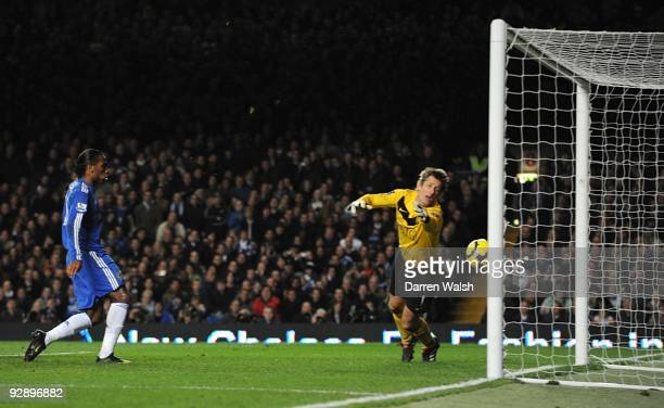 Edwin Van der Sar of Manchester United dives in vain as John Terry's header crosses the line during the Barclays Premier League match between Chelsea...