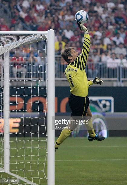 Edwin van der Sar of Manchester United makes a save during the MLS All Star Game at Reliant Stadium on July 28, 2010 in Houston, Texas.