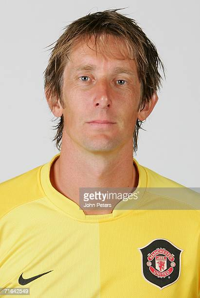 Edwin van der Sar of Manchester United poses during an official photocall at Carrington Training Ground on August 10 2006 in Manchester England