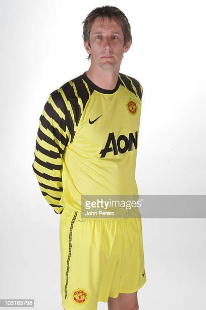 Edwin van der Sar of Manchester United poses in the new Manchester United home kit for the 2010/2011 season on April 14 2010 in Manchester England