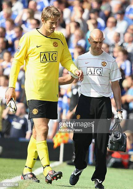 Edwin van der Sar of Manchester United receives treatment from physio Rob Swire during the FA Premier League match between Chelsea and Manchester...