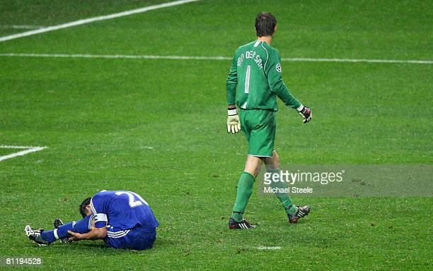 Edwin Van der Sar of Manchester United walks past John Terry of Chelsea who has just missed a penalty attempt during the UEFA Champions League Final...