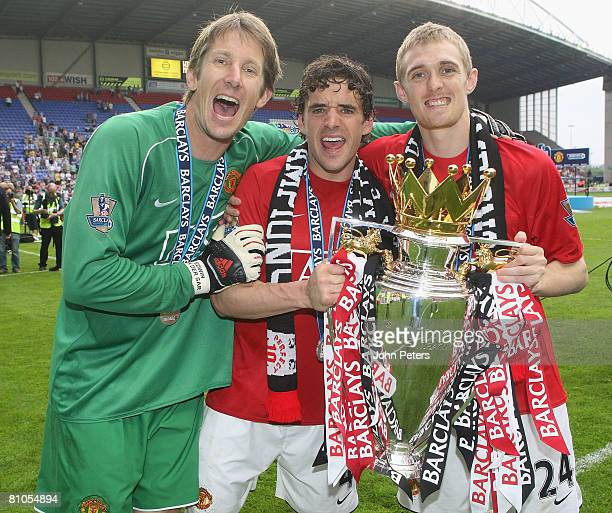 Edwin van der Sar Owen Hargreaves and Darren Fletcher of Manchester United celebrates with the Premier League trophy on the pitch after the Barclays...