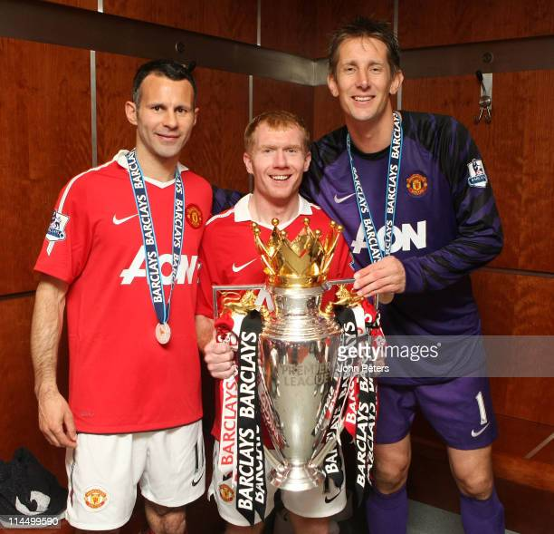 Edwin van der Sar Ryan Giggs and Paul Scholes of Manchester United poses in the dressing room with the Barclays Premier League trophy after the...