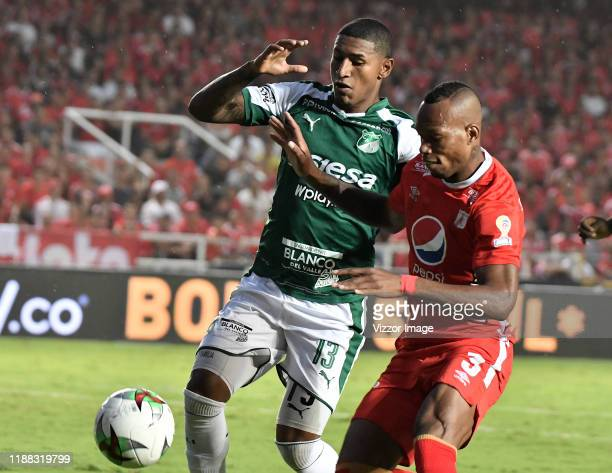 Edwin Velasco of America struggles the ball with Juan Camilo Angulo of Cali during a match between America de Cali and Deportivo Cali as part of Liga...