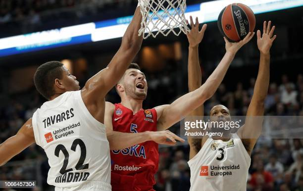 Edy Tavares and Anthony Randolph of Real Madrid try to block Alec Peters of CSKA Moscow attempting to score during Turkish Airlines Euroleague week...