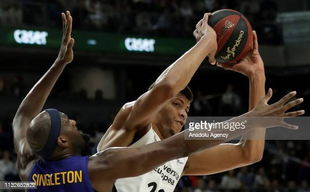 Edy Tavares of Real Madrid in action against Chris Singleton of Barcelona Lassa during the Liga Endesa week 24 match between Real Madrid and FC...