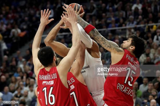 Edy Tavares of Real Madrid in action against Georgios Printezis and Kostas Papanikolaou of Olympiacos during Turkish Airlines Euroleague Week 18...