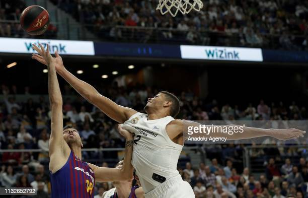Edy Tavares of Real Madrid in action against Pierre Oriola of Barcelona Lassa during the Liga Endesa week 24 match between Real Madrid and FC...