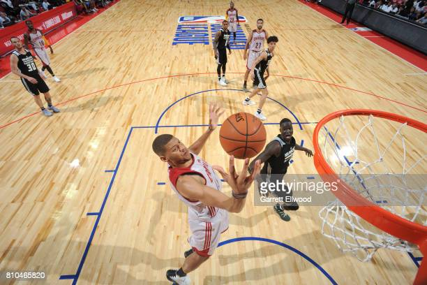 Edy Tavares of the Cleveland Cavaliers grabs the rebound against the Milwaukee Bucks on July 7 2017 at the Thomas Mack Center in Las Vegas Nevada...