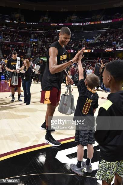 Edy Tavares of the Cleveland Cavaliers high fives a fan before the open practice on October 2 2017 at Quicken Loans Arena in Cleveland Ohio NOTE TO...