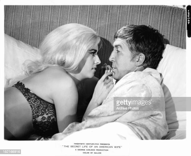 Edy Williams and Patrick O'Neal lie in bed together in a scene from the film 'The Secret Life Of An American Wife' 1968