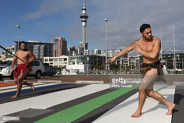 Edz Eramiha and Iwi Matthews perform a traditional maori welcome for UFC fighters at Te Wero Bridge on June 24 2014 in Auckland New Zealand Fighters...