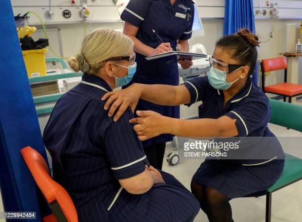 Eearing a protective face coverings to combat the spread of the coronavirus, Matron May Parsons talks to Heather Price during training in the...