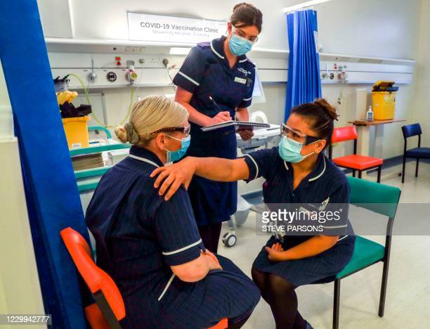 Eearing a protective face coverings to combat the spread of the coronavirus, Matron May Parsons is assessed by Victoria Parker during training in the...
