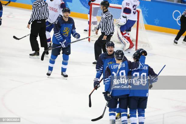 Eeli Tolvanen of Finland celebrates scoring a goal with teammates during the Men's Ice Hockey Preliminary game between Finland and Norway at...