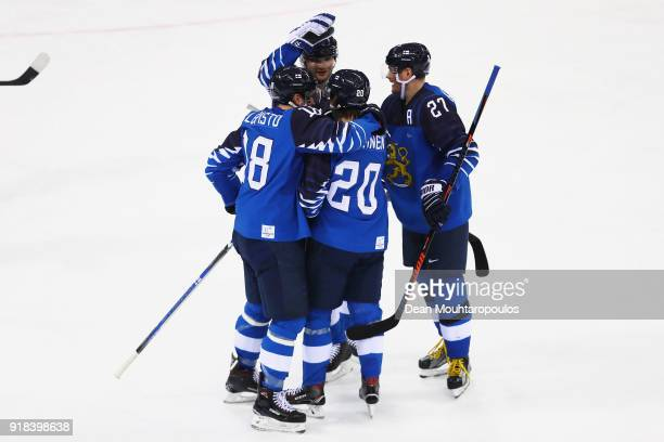 Eeli Tolvanen of Finland celebrates scoring his teams fourth goal of the game with team mates during the Men's Ice Hockey Preliminary Round Group C...