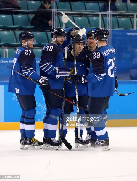 Eeli Tolvanen of Finland celebrates with his teammates after scoring a goal on Lars Haugen of Norway in the first period during the Men's Ice Hockey...