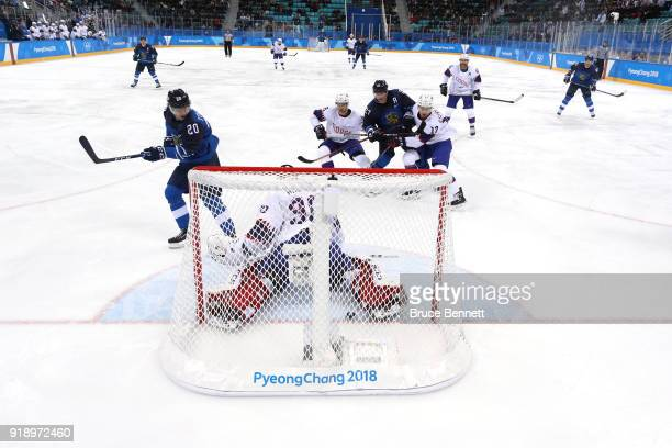 Eeli Tolvanen of Finland scores a goal against Lars Haugen of Norway in the second period during the Men's Ice Hockey Preliminary Round Group C game...