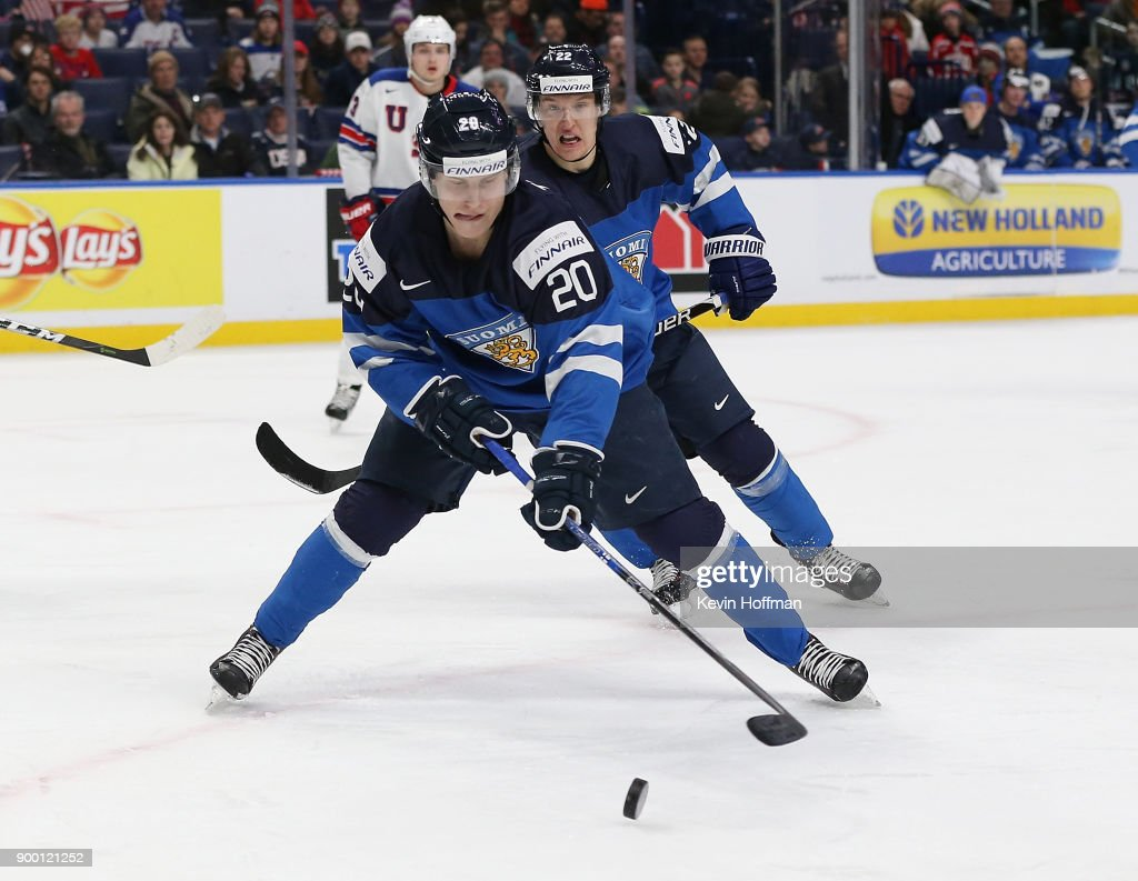 Eeli Tolvanen #20 of Finland skates up ice with the puck in the second period against the United States during the IIHF World Junior Championship at KeyBank Center on December 31, 2017 in Buffalo, New York.
