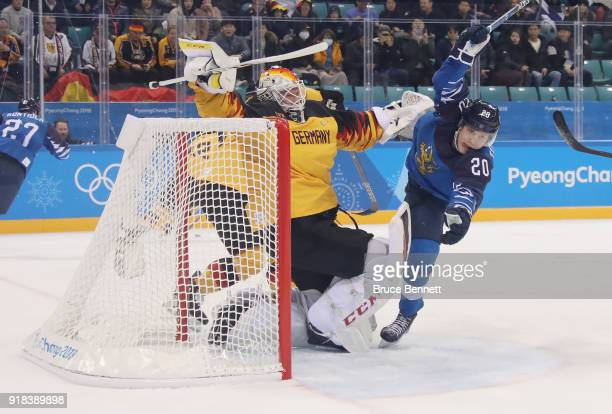 Eeli Tolvanen of Finland takes a penalty for interfering with Danny Aus Den Birken of Germany during the first period during the Men's Ice Hockey...
