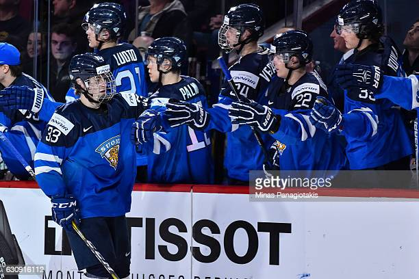 Eeli Tolvanen of Team Finland celebrates his first period goal with teammates on the bench during the 2017 IIHF World Junior Championship relegation...
