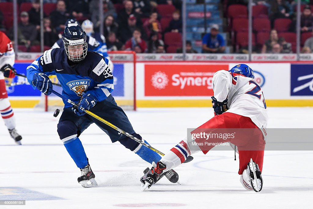 Eeli Tolvanen #33 of Team Finland plays the puck past Filip Hronek #29 of Team Czech Republic during the IIHF World Junior Championship preliminary round game at the Bell Centre on December 26, 2016 in Montreal, Quebec, Canada.