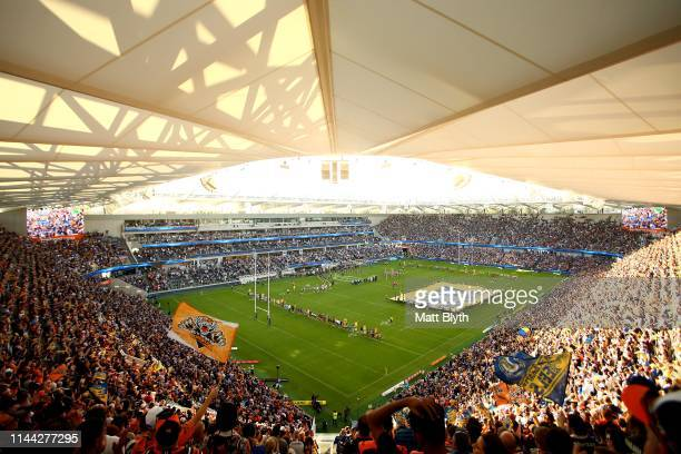 Eels and Tigers player sing the national anthem before the round 6 NRL match between the Parramatta Eels and Wests Tigers at Bankwest Stadium on...