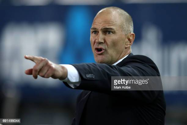 Eels coach Brad Arthur shouts as he watches on from the bench during the round 13 NRL match between the Parramatta Eels and the New Zealand Warriors...