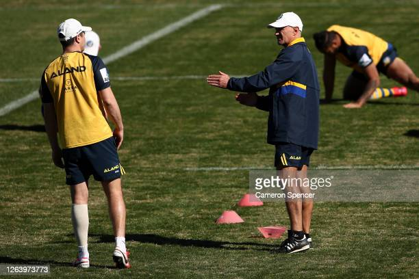 Eels coach Brad Arthur talks to Mitchell Moses of the Eels during a Parramatta Eels NRL training session at Kellyville Park on August 05 2020 in...