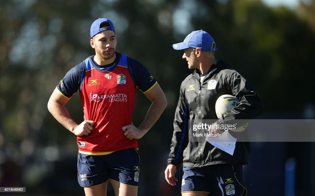 Eels head coach Brad Arthur talks to Corey Norman during a Parramatta Eels NRL training session at on July 25, 2017 in Sydney, Australia.