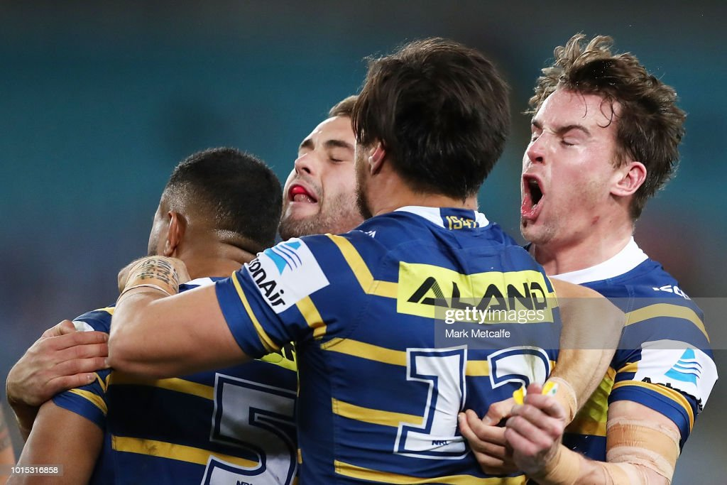 Eels players celebrate a tackle by George Jennings of the Eels during the round 22 NRL match between the Parramatta Eels and the St George Illawarra Dragons at ANZ Stadium on August 11, 2018 in Sydney, Australia.