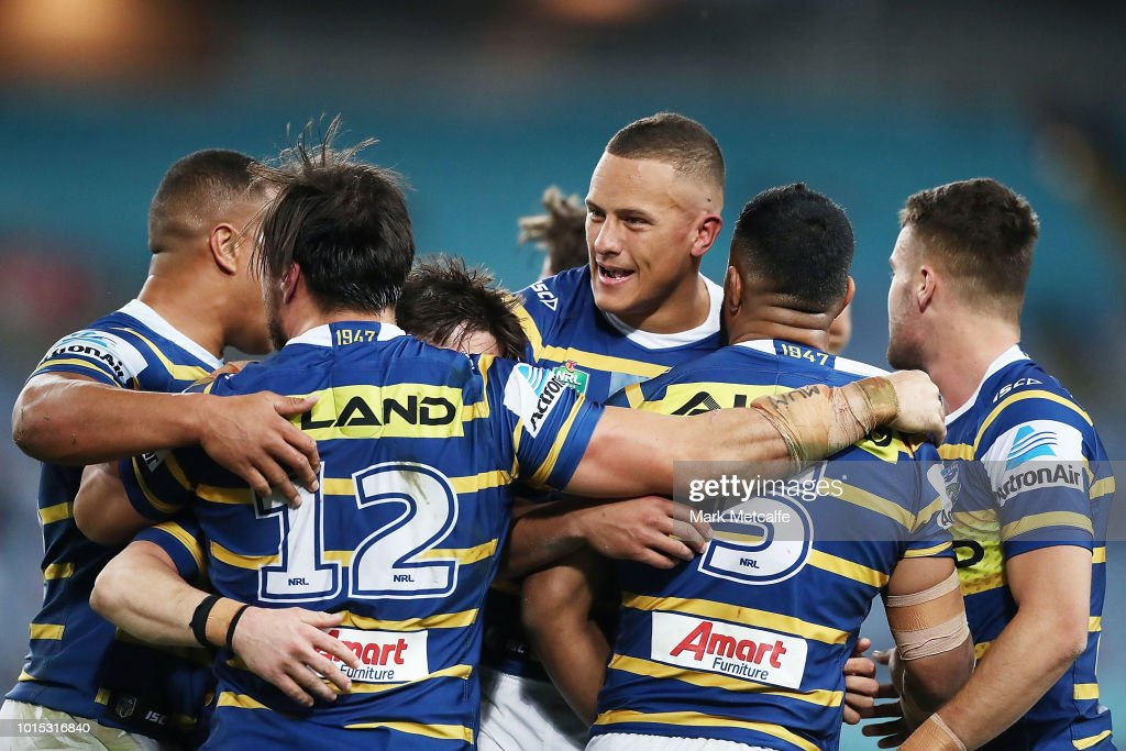 Eels players celebrate a tackle by Kane Evans of the Eels during the round 22 NRL match between the Parramatta Eels and the St George Illawarra Dragons at ANZ Stadium on August 11, 2018 in Sydney, Australia.
