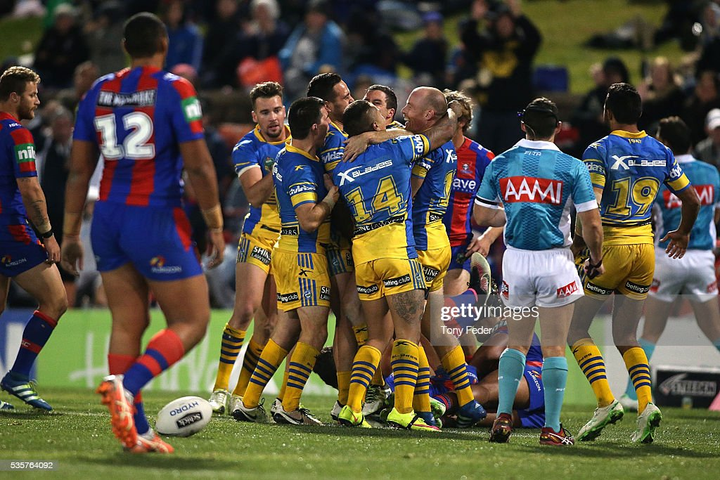 Eels players celebrate a try during the round 12 NRL match between the Newcastle Knights and the Parramatta Eels at Hunter Stadium on May 30, 2016 in Newcastle, Australia.