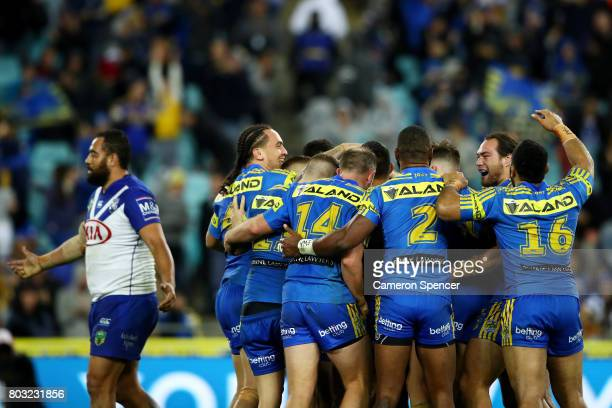 Eels players celebrate winning in extratime during the round 17 NRL match between the Parramatta Eels and the Canterbury Bulldogs at ANZ Stadium on...