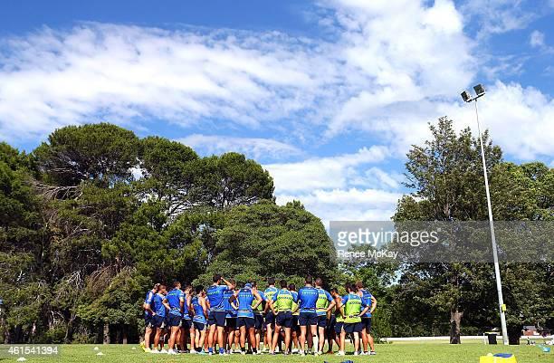 Eels players huddle together during a Parramatta Eels NRL preseason training session at Parramatta Stadium on January 15 2015 in Sydney Australia