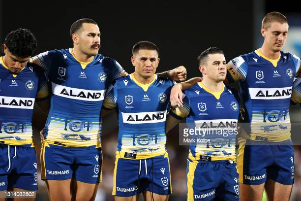 Eels players pause during an ANZAC ceremony before the round seven NRL match between the Parramatta Eels and the Brisbane Broncos at TIO Stadium, on...