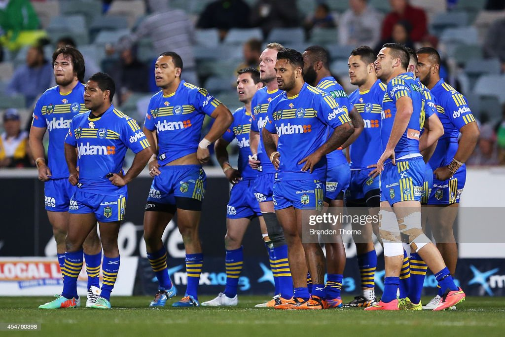 Eels players show their dejection after conceding a try during the round 26 NRL match between the Canberra Raiders and the Parramatta Eels at GIO Stadium on September 6, 2014 in Canberra, Australia.