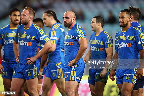 Eels players show their dejection during the round 21 NRL match between the Parramatta Eels and the Wests Tigers at ANZ Stadium on July 30 2016 in...