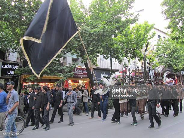 CONTENT] Een optocht in Isfahan Iran om de martelaren van de oorlog tussen Iran en Irak te herdenken