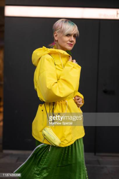 Eena Irina is seen wearing yellow rain coat green pleated skirt during the Amazon Fashion Week TOKYO 2019 A/W on March 21 2019 in Tokyo Japan
