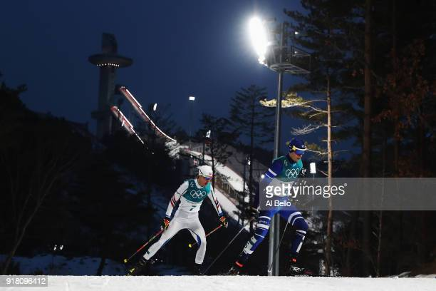 Eero Hirvonen of Finland and Espen Andersen of Norway compete during the Nordic Combined Individual Gundersen Normal Hill and 10km Cross Country on...