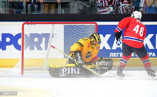 Eero Kilpelainen of KalPa Kuopio and Jon Rheault of Adler Mannheim during the Champions Hockey League game between Adler Mannheim and KalPa Kuopio on...