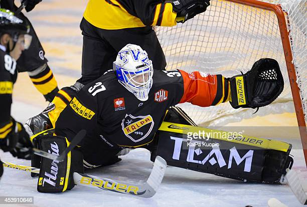 Eero Kilpelainen tryes to save while the goal is nearly tipped over him during the Champions Hockey League game between KalPa Kuopio and Sparta...