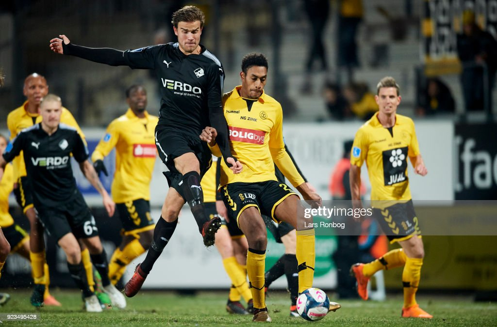 Eero Markkanen of Randers FC and Mikkel Qvist of AC Horsens compete for the ball during the Danish Alka Superliga match between Randers FC and Hobro IK at BioNutria Park on February 18, 2018 in Randers, Denmark.