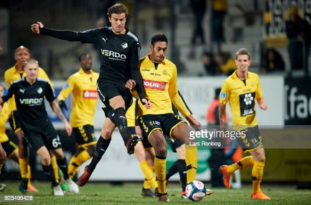 Eero Markkanen of Randers FC and Mikkel Qvist of AC Horsens compete for the ball during the Danish Alka Superliga match between Randers FC and Hobro...